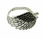 Silver cuff in wing form with black crystals